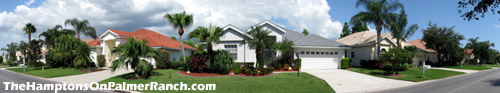 Street view of some typical homes within The Hamptons community - located on Palmer Ranch in Sarasota, FL.